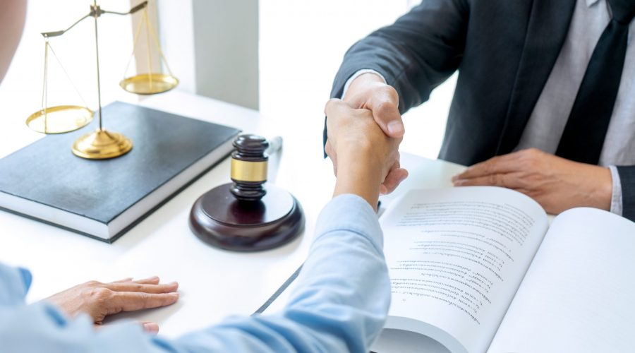 Lawyer,Or,Judge,With,Gavel,And,Balance,Handshake,With,Client