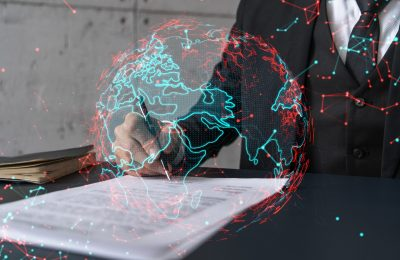 Businessman,In,Suit,Signs,Contract.,Double,Exposure,With,World,Map