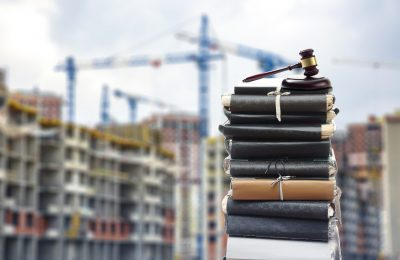 Document,Files,With,Gavel,On,Buildings,Under,Construction